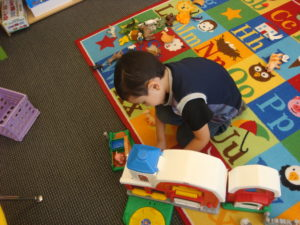 Buckeye Preschool Child enjoying solitary play in the classroom and emotional support from his teachers